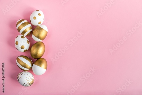 Top view of easter eggs colored with golden paint Wallpaper Mural