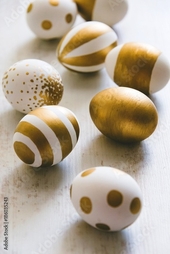 Close up of easter eggs colored with golden paint Canvas Print
