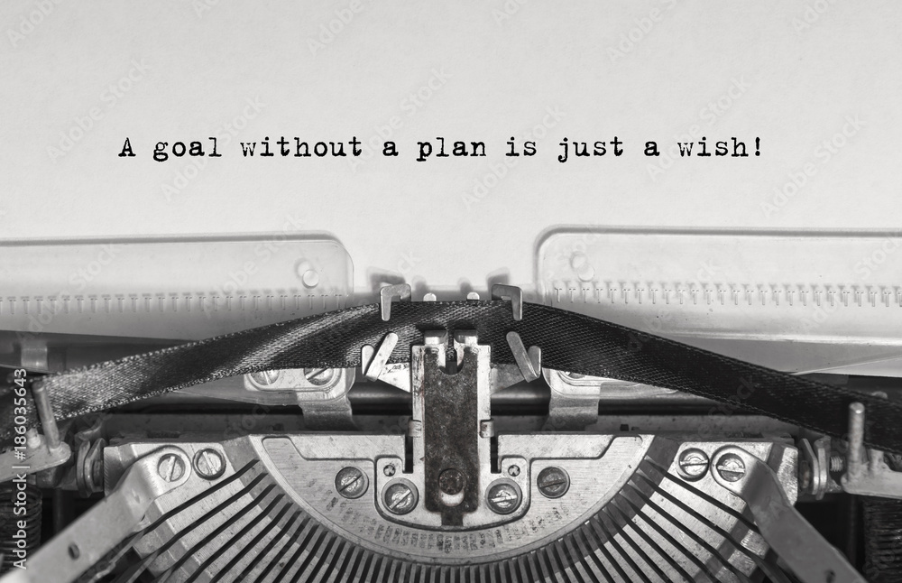 Fotografía A goal without a plan is just a wish! close up, typed words on a vintage typewri