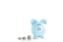 Blue Piggy Bank And Coins Isol...