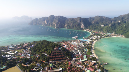 Aerial drone view of main Pier Ton Sai  on Phi Phi Island during sunny summer day, Thailand