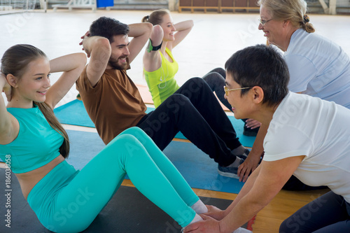 Fototapety, obrazy: Group of people in a gym