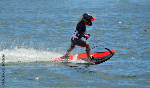 Poster Nautique motorise Female Motosurf Competitor moving at speed.