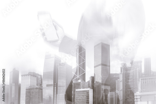 Double exposure of businessman and Hong Kong city view with yellow color Poster