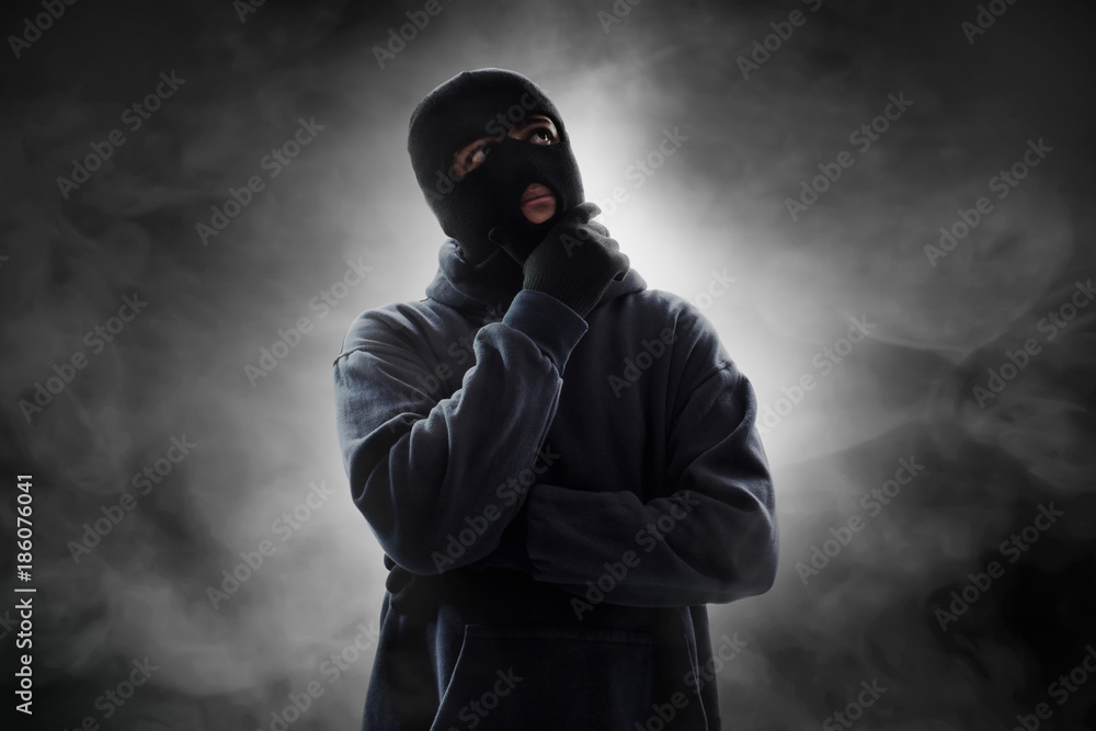 Fototapeta Masked thief thinking