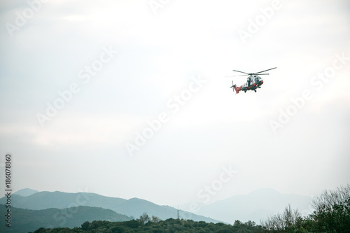 Tuinposter Helicopter Flying helicopter