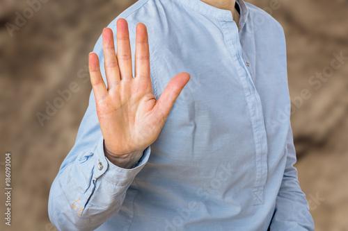 Obraz na plátně  Woman signals defensive attitude with hand