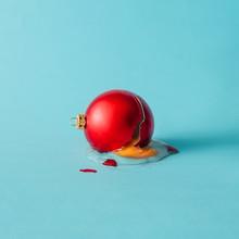 Broken Christmas Bauble Decoration With Broken Egg. Minimal Concept.