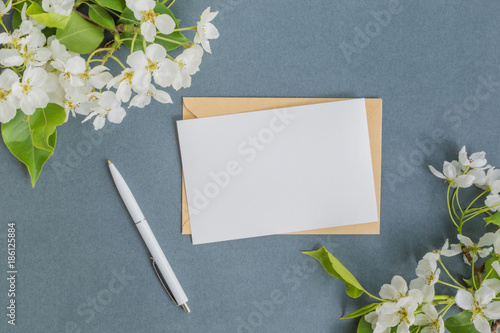Fotografie, Obraz  Mockup white greeting card with white spring flowers