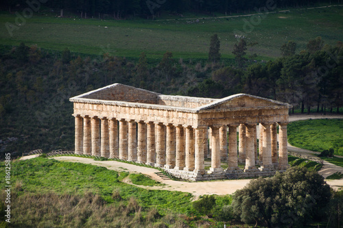 Fotografia, Obraz Summer landscape with ancient Greek temple of Venus, Segesta village, Sicily, Italy