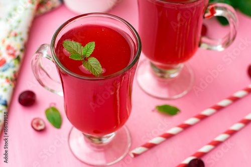 Russian traditional drink kissel with cranberries and mint