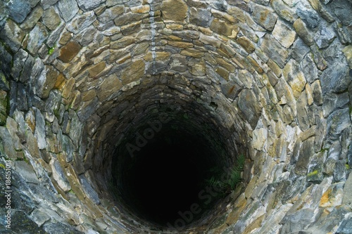 Deep water well in the town, inside. Slovakia Canvas Print