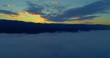 Aerial View. Flying over the clouds . Aerial camera shot. During the sunset. Landscape panorama.