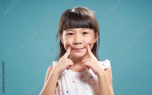 Fotografía  Portrait of little young cute asian  girl  .