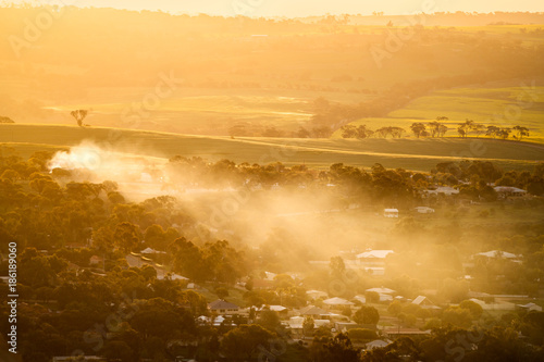 Staande foto Meloen Smoke from a fire spreads over the small town of York, Western Australia, and it's surrounding farmland of canola fields.