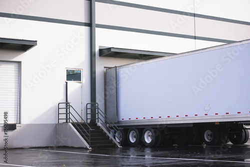 Canvas Print Dry van semi trailer loading and unloading commercial cargo in warehouse dock