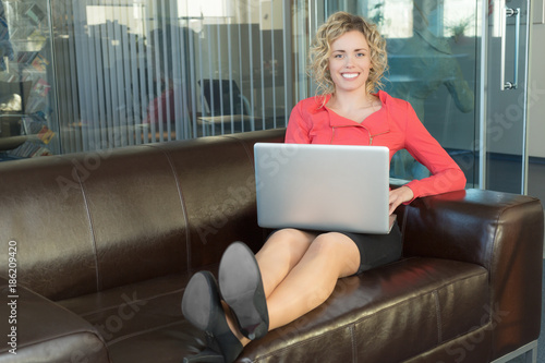 Fotografie, Obraz  a sympathetic business woman in a big office