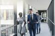 Business people walking on office floor
