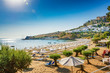 View of sandy beach in Bay of Lindos, Acropolis in background (Rhodes, Greece)