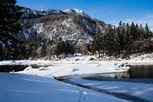 Alpine Mountain Pass Winter Scenery Landscape By Lake Lago Del Predil In Sunny Blue Sky In Snowfall, Italy