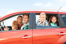Young Family With Children And Dog In Car
