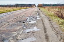 Dangerous Asphalt Road With Ho...