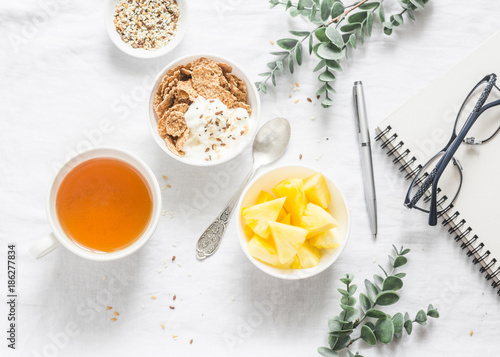 Fototapeta Flat lay morning breakfast inspiration - greek yogurt with whole grain cereals,