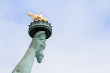 Close Up Of Torch Of The Statue Of Liberty In New York City. This Is The Copper Statue Which Is A Gift From The People Of France To The People Of The United States. It's A Famous Attraction In US.
