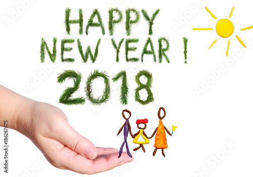 greetings words happy new year happy family walking under the yellow bright sun shining
