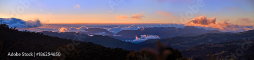 Panoramic view of Cerro de la Muerte Costa Rica with a volcano in the clouds, illuminated by the setting sun Canvas Print