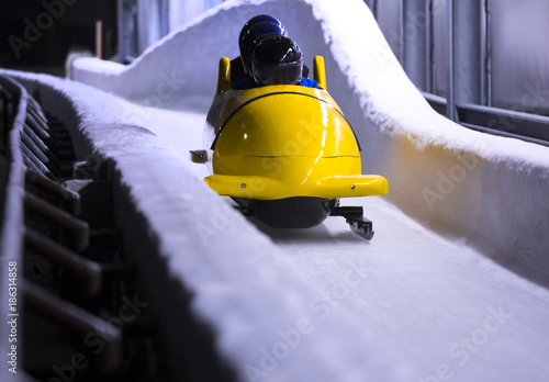 Ingelijste posters Wintersporten bob sled speeding in an ice channel