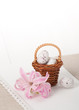 Little Braided Wooden Basket With Chocolate Eggs On Handmade Natural Linen Napkin. Hyacinth Flowers