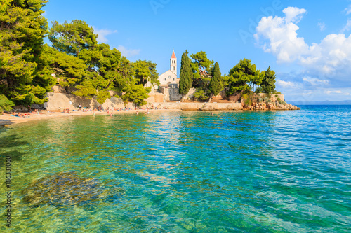 Spoed Foto op Canvas Eiland Stunning sea bay with beach and view of Dominican monastery in distance, Bol town, Brac island, Croatia