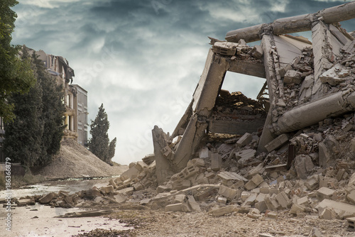 View on a collapsed concrete industrial building with dark dramatic sky above Fotobehang