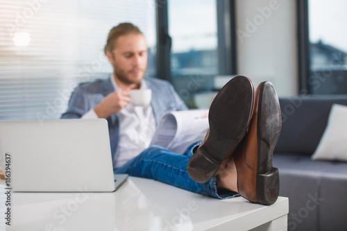 Relaxed Office Employee Braking Off In