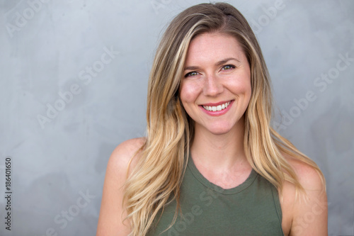 Fototapeta  Cute natural blonde woman smiling with perfect white teeth and glowing skin