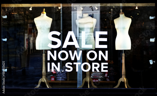 34c9cb55b97 sale shop window sign at night illuminated lights clothes store at mall late