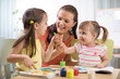 Children and mother with finger paints
