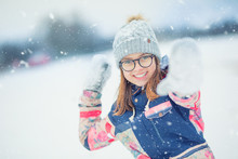 Winter Happy Teen Girl  Playing In Snow Throwing Snowball