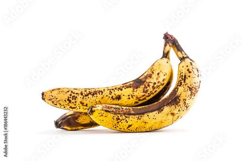 Fotografía Banana. Over ripe bananas isolated on white with shadows