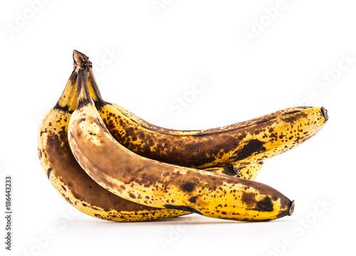 Valokuva  Banana. Over ripe bananas isolated on white with shadows