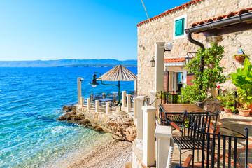 Small coastal restaurant on beach in Bol town, Brac island, Croatia