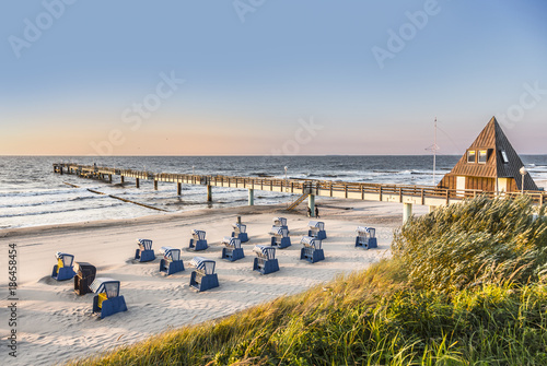 Obraz beach chairs in morning light at the beach - fototapety do salonu