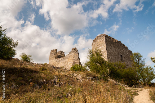 Ruins On Top Of Hill With Blue Sky And White Clouds In