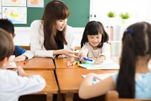 Teacher And Children Drawing I...