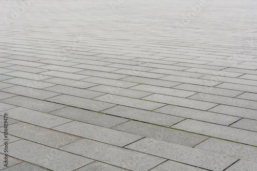 Pinturas sobre lienzo  Grey brick stone street road. Light sidewalk, pavement texture