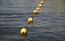 The Yellow Buoy Which Floats On The Sea Surface Of The Port