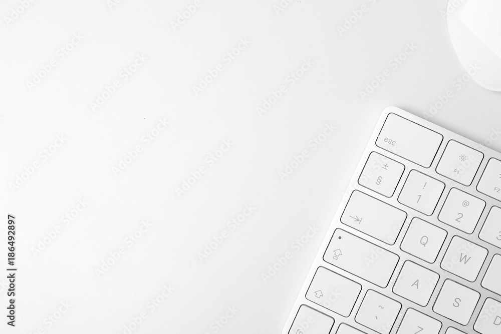 Fototapeta Apple keyboard and mouse on white table