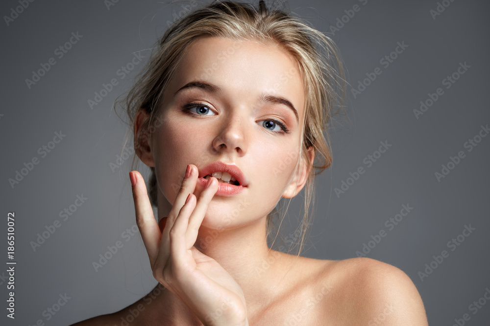 Fototapety, obrazy: Image with beautiful blonde girl touching her lips on grey background. Beauty & Skin care concept