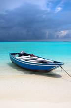 Blue Maldivian Boat On The White Sand Beach